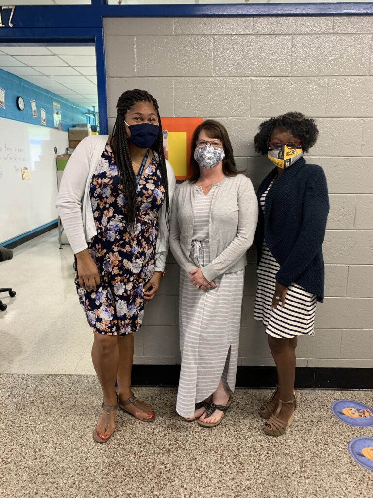 Three teachers posed to show readiness and excitement for Open House.