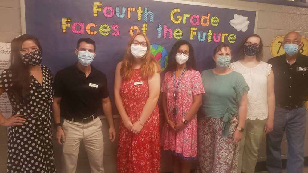 Two student interns and the custodian posed with four teachers to show readiness and excitement for Open House.
