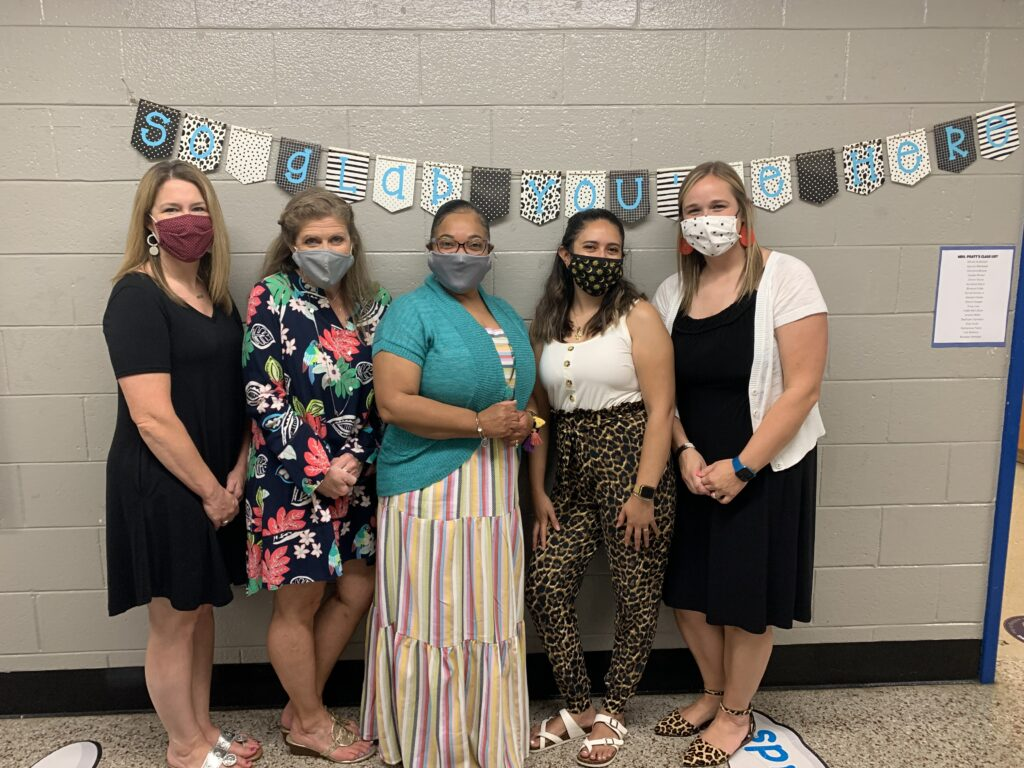 First and second grade teachers posed with media specialist, Heather Kelley, to show readiness and excitement for Open House.