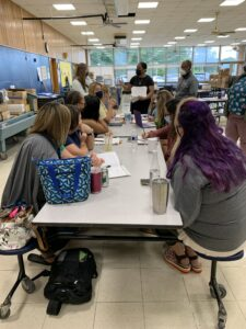 Mrs. Perkinson sharing strategies for emergent writers.