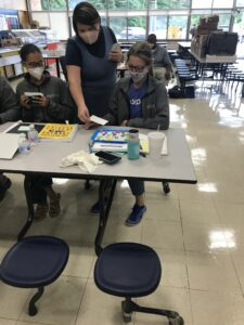 Mrs. Ashley monitors while two teachers partner up to model making a word activity.