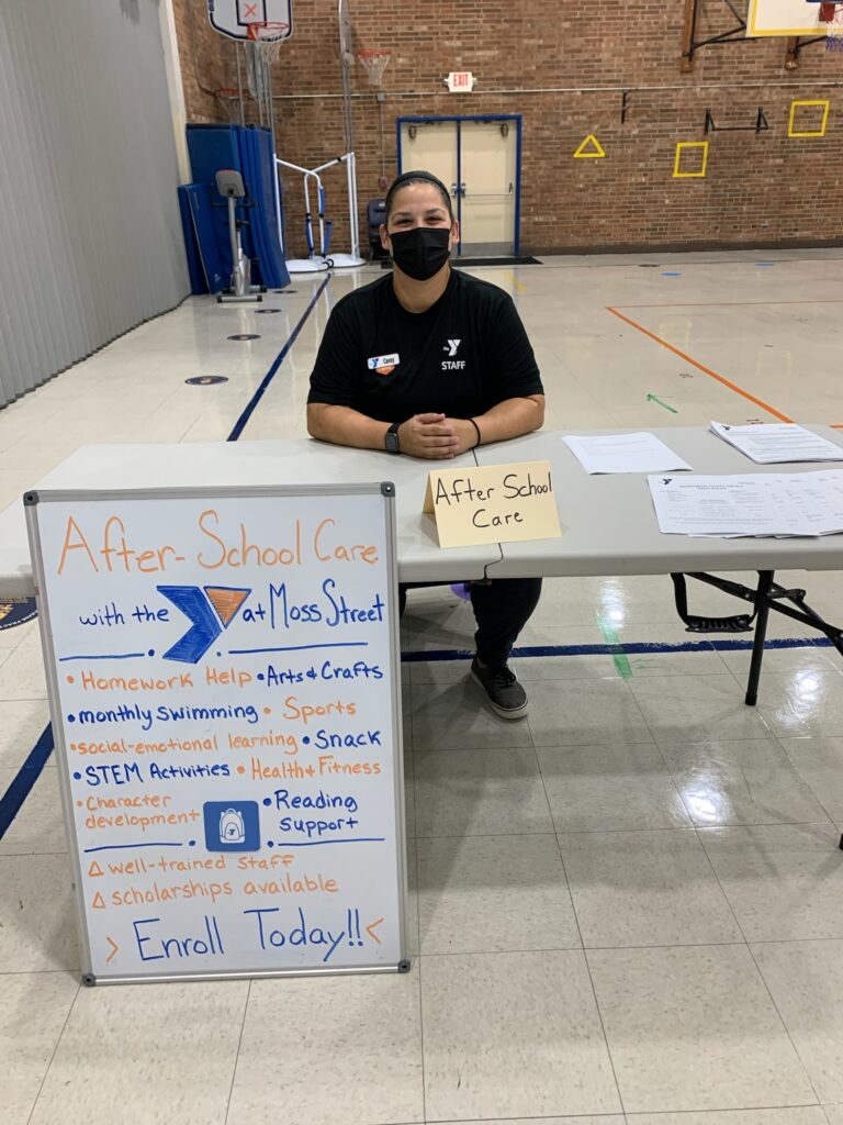 This YMCA staff had a table to introduce the YMCA after school program to parents.