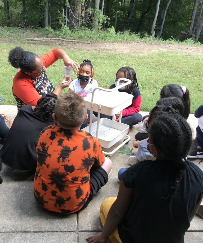 Mrs. Johnson's students were able to observe the rock being removed from the cup and watched intently.