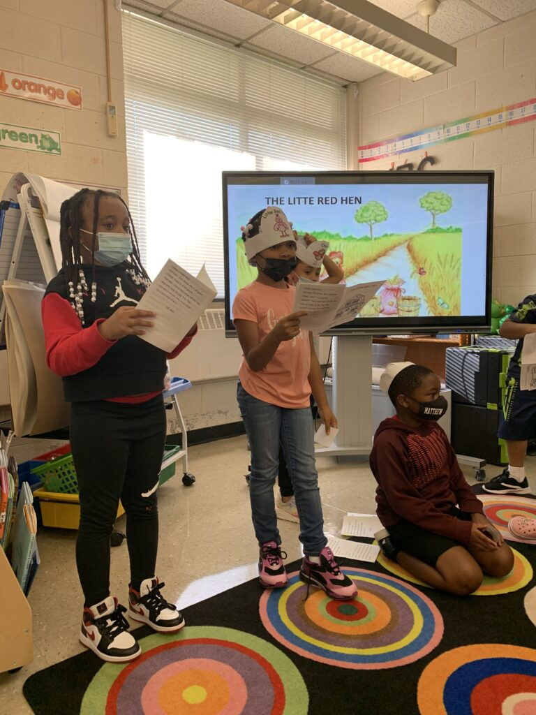 Students stood when it was time to read their parts of the play.