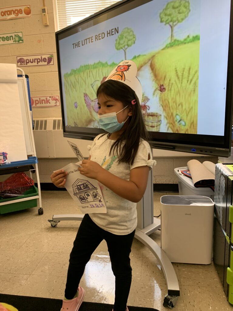 The students wore hats with their roles labeled on them.